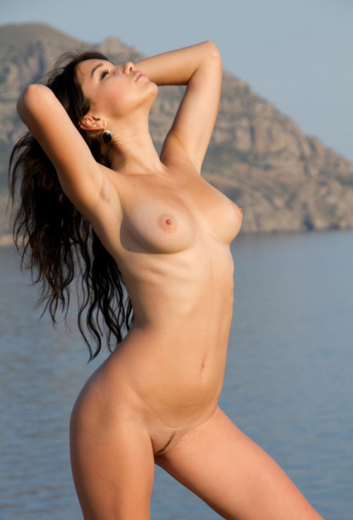 Beautiful naked body and the sea are always in harmony