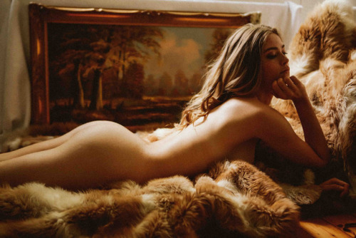 naked girl on a fur rug