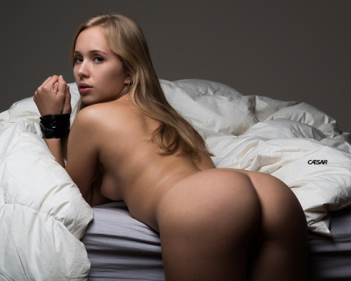 Playing with her ass on the bed