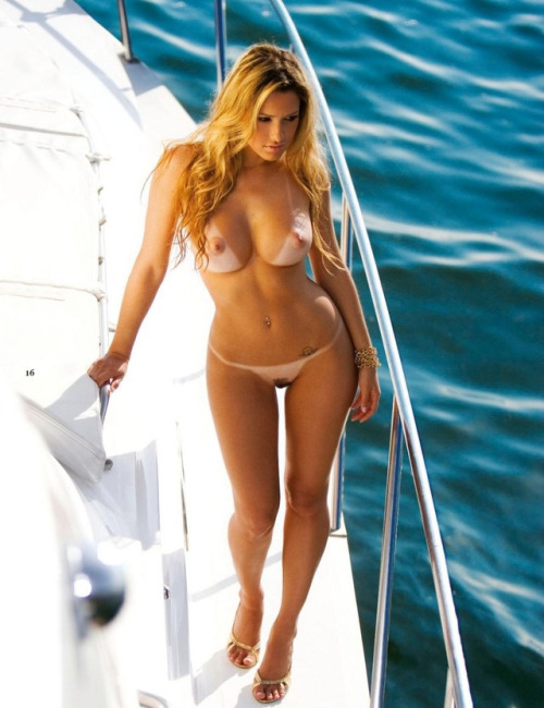 Naked blonde girl looking for adventure on the boat