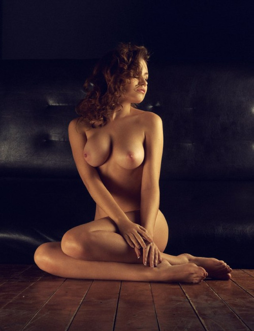 Naked brunette on the floor