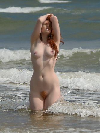 Sea and nude red-head girl