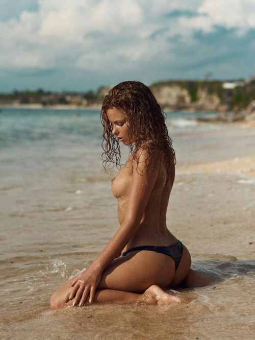Wet and nude on the beach