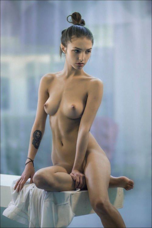 Naked girl posing on a chair