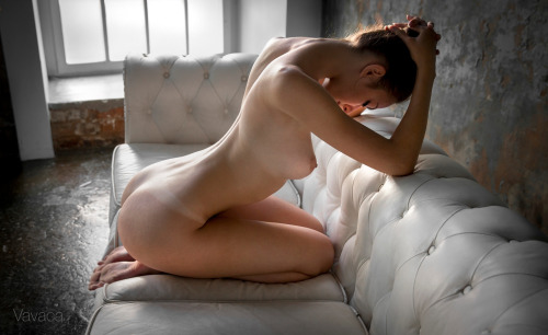 bent over naked in a strange position