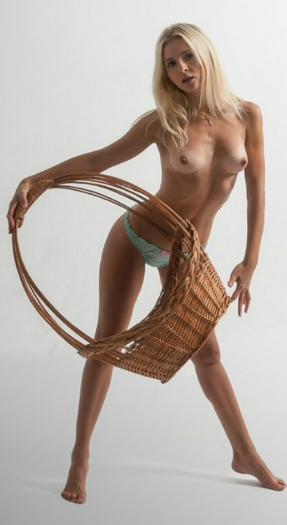 Blonde poses with a wicker basket