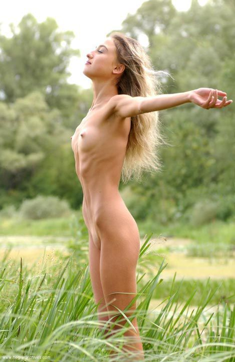 Sexy slender nude girl moves towards wind