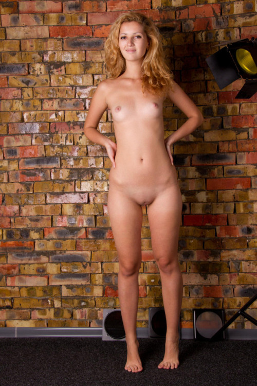 Naked student suddenly appeared naked in a stone wall
