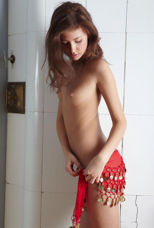Sexy slender redhead girl in strange clothes