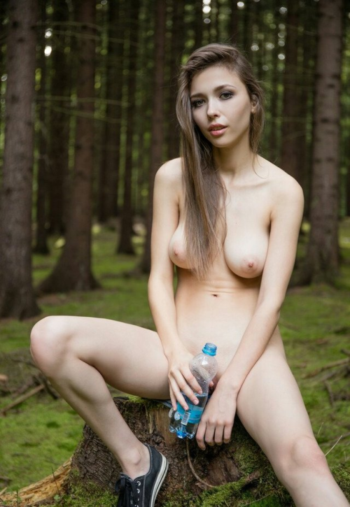 Nude girl with bottle have a rest in the wood