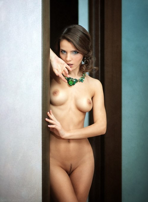 Nude slender girl with expressive eyes