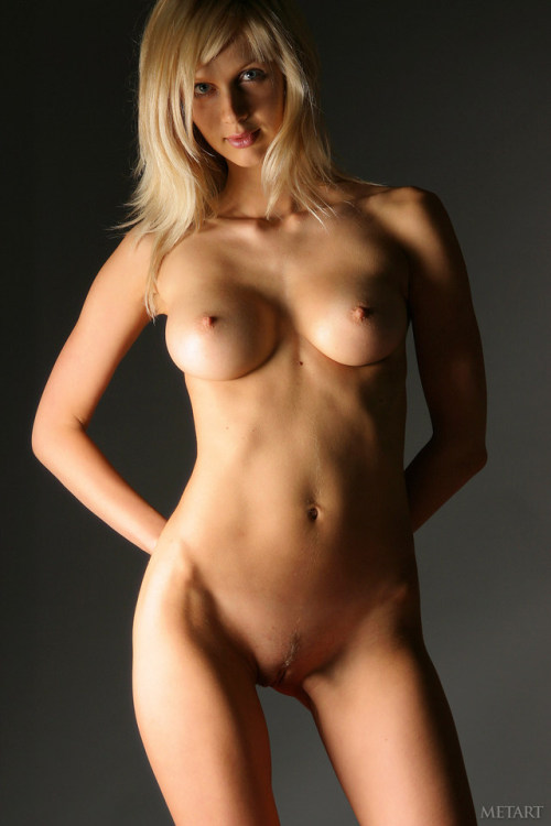 Playful  blonde nude bitch in the dark room