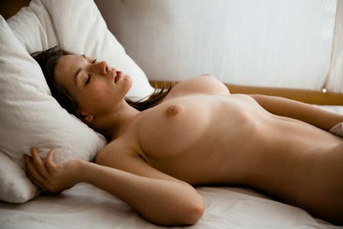 Nude beautiful is girl sleeping with her dreams
