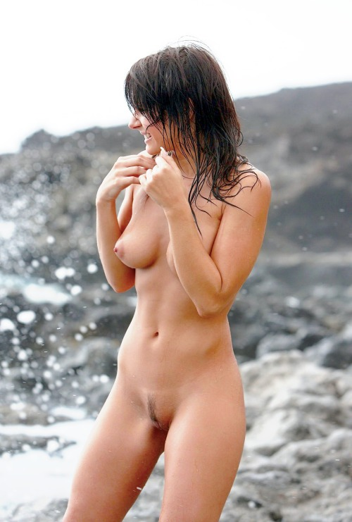 Naked wet brunette girl with sharp breasts