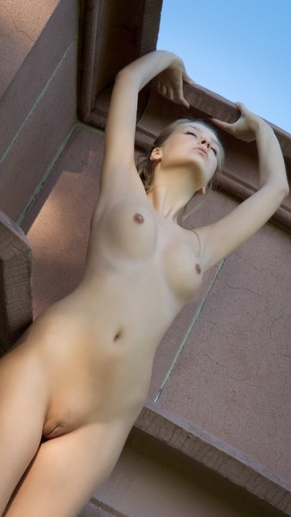 Sexy nude beautiful slender blonde girl dreaming