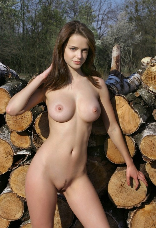 Posing at a warehouse of logs in a naked look is considered as the highest class
