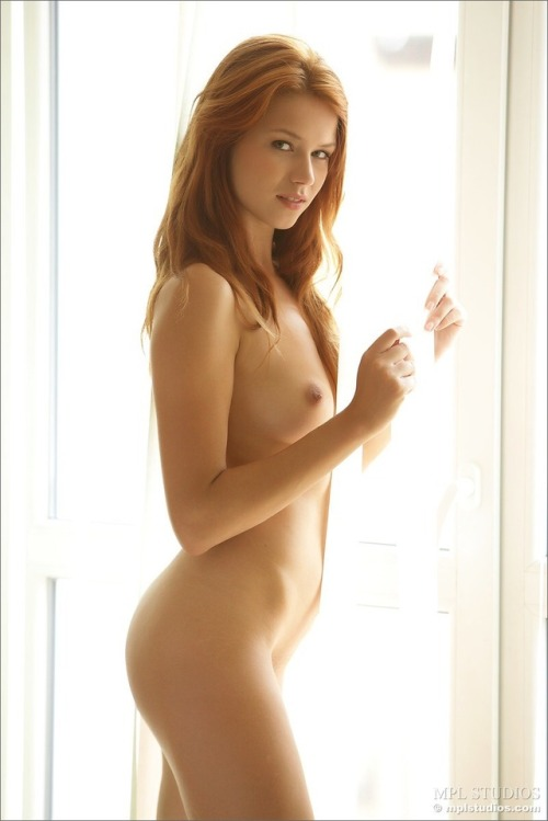 Nude slim artful red-haired girl